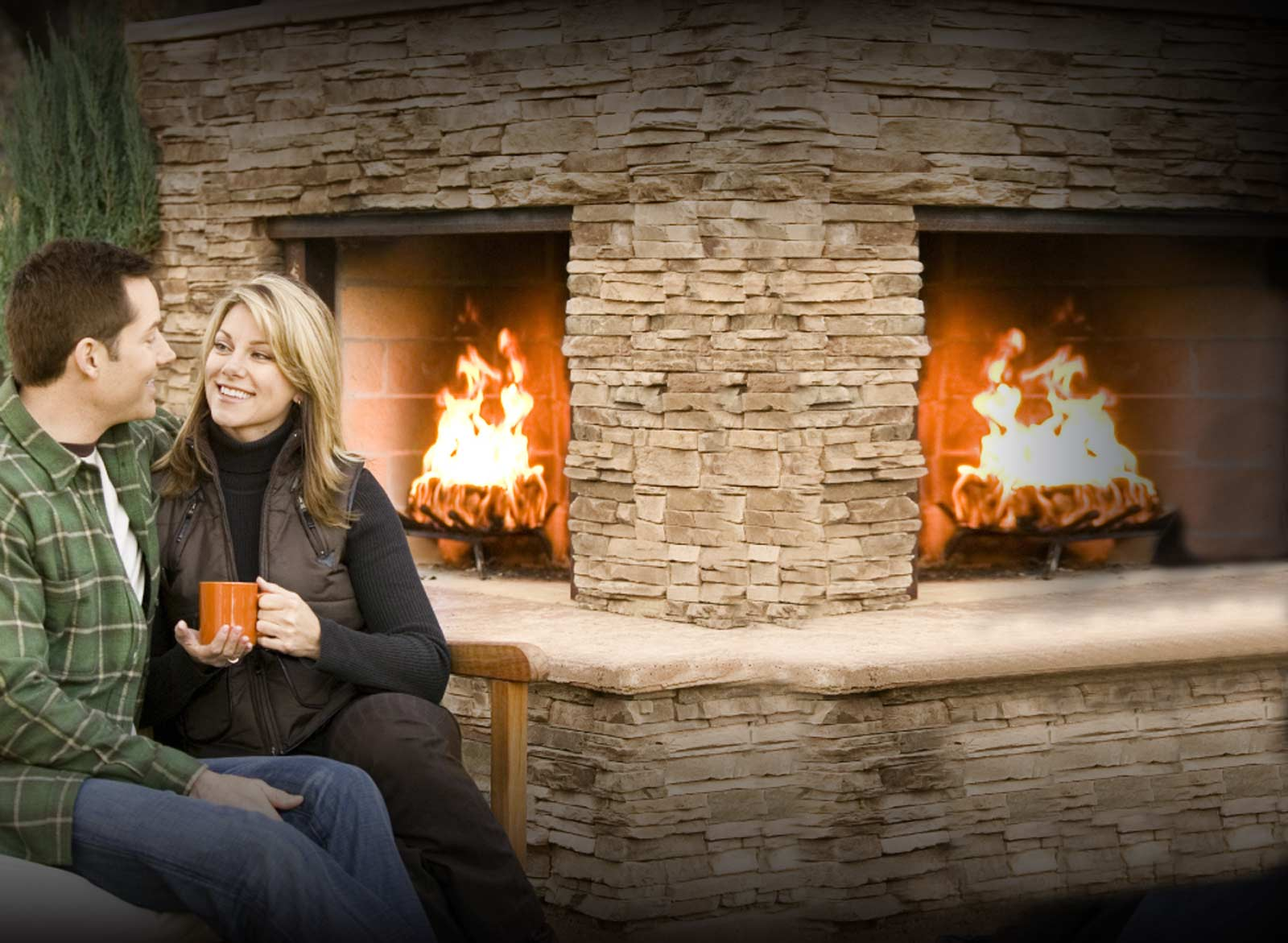 picture of man and woman sitting by fireplace